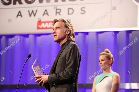 Bill Pohlad accepts the 'Best Time Capsule' award from Elizabeth Banks, looking on from right, at AARP's 15th Annual Movies for Grownups Awards at the Beverly Wilshire Hotel, in Beverly Hills, Calif