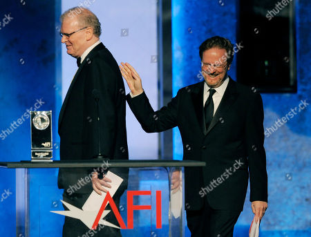 Sir Howard Stringer, left, introduces AFI President Bob Gazzale to the stage during the American Film Institute's 41st Lifetime Achievement Award Gala honoring Mel Brooks at the Dolby Theatre on in Los Angeles
