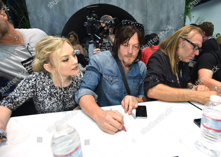 "Emily Kinney, and from left, Norman Reedus and Gregory Nicotero attend AMC's ""The Walking Dead"" autograph signing on Day 2 of Comic-Con International, in San Diego"