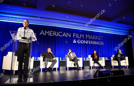Stock Image of Jonathan Wolf, Executive Vice President & Managing Director of the American Film Market, Bruce Eisen, President of Digital Advisors, Steve Nickerson, President of Home Entertainment, Erick Opeka, Executive Vice President of Digital Networks at Cinedigm Entertainment, Hanny Patel, Vice President of Video Marketing for AT&T Entertainment Group, and Meyer Shwarzstein, President of Brainstorm Media, speak at the American Film Market Distribution Conference: The Future of Video On Demand at the Fairmont Hotel, in Santa Monica, Calif