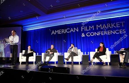 Stock Picture of Jonathan Wolf, Executive Vice President & Managing Director of the American Film Market, Bruce Eisen, President of Digital Advisors, Steve Nickerson, President of Home Entertainment, Erick Opeka, Executive Vice President of Digital Networks at Cinedigm Entertainment, and Hanny Patel, Vice President of Video Marketing for AT&T Entertainment Group, speak at the American Film Market Distribution Conference: The Future of Video On Demand at the Fairmont Hotel, in Santa Monica, Calif