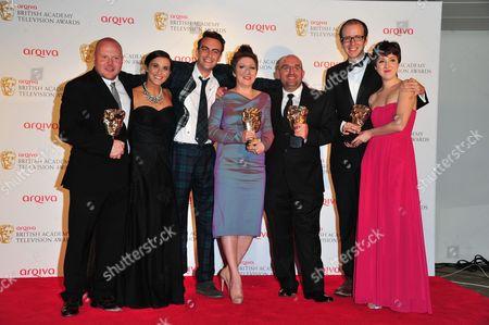 Winners for Best Mini Series for 'This Is England '88' Mark Herbert, Vicky McClure, Joseph Gilgun, Rebekah Wray-Rogers, Shane Meadows, Jack Thorne and Rosamund Hanson poses at the BAFTA TV Awards, in London