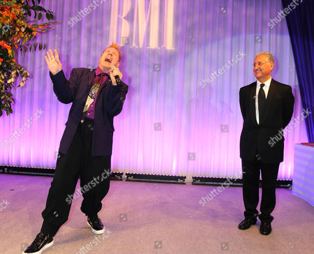 John Lydon, winner of the BMI Icon Award 2013 with Del Bryant at the BMI London Awards 2013, held at the Dorchester Hotel, London, on