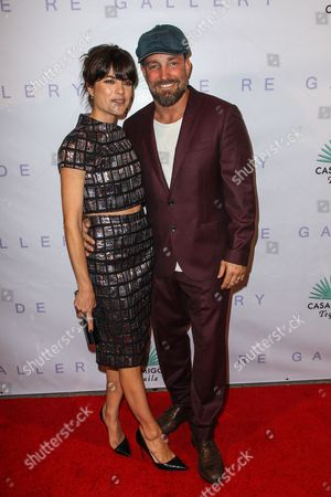 """Selma Blair, left, and Brian Bowen Smith attend the Brian Bowen Smith's """"Metallic Life"""" Exhibition Debut at the De Re Gallery on in Los Angeles"""