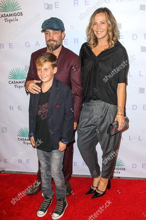 "Brian Bowen Smith, Shea Bowen Smith and son Jona Bowen Smith attend the Brian Bowen Smith's ""Metallic Life"" Exhibition Debut at the De Re Gallery on in Los Angeles"