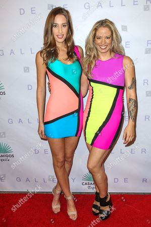 """Stock Photo of Sterling Zayas, left, and Brynn Taylor attend the Brian Bowen Smith's """"Metallic Life"""" Exhibition Debut at the De Re Gallery on in Los Angeles"""