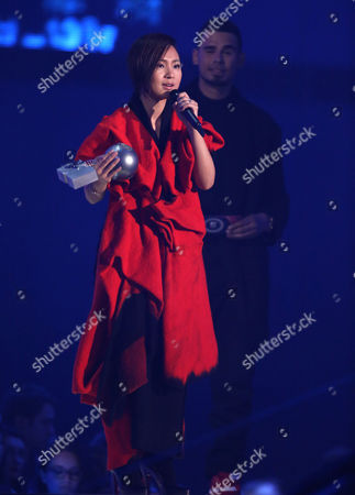 Stock Picture of Bibi Zhou on stage during the 2014 MTV European Music Awards in Glasgow
