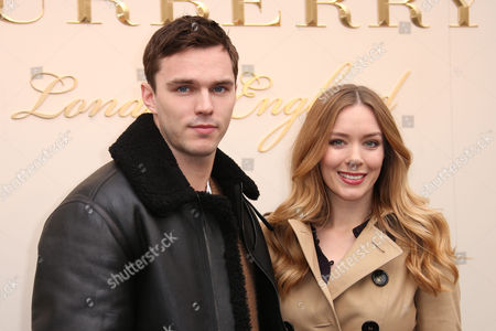 Nicholas Hoult Nicholas and Rosanna Hoult pose for photographers upon arrival at the Autumn Winter 2016 Burberry Prorsum show in London