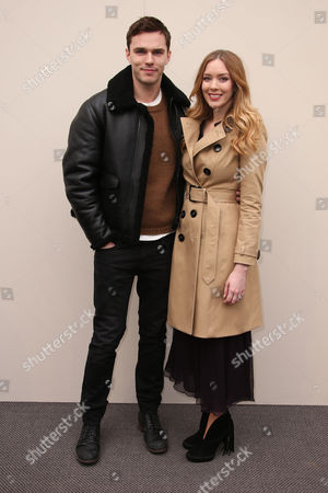 Stock Image of Nicholas Hoult Nicholas and Rosanna Hoult pose for photographers upon arrival at the Autumn Winter 2016 Burberry Prorsum show in London