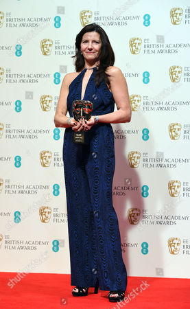 Christine Langan, winner of Outstanding Contribution to British Film for The BBC, poses for photographers in the winners room, at the British Academy Film and Television Awards 2015, The BAFTAs, at the Royal Opera House, in London
