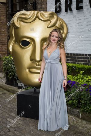 Stock Image of Faye Thomas poses for photographers upon arrival at the British Academy Television Craft Awards in London