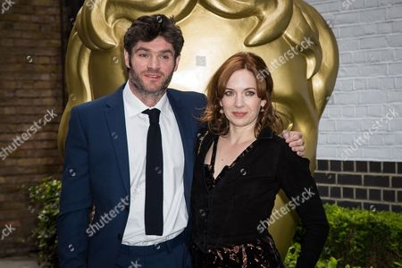 Harry Peacock and Katherine Parkinson pose for photographers upon arrival at the British Academy Television Craft Awards in London