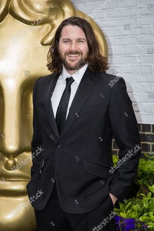 Kieran Bew poses for photographers upon arrival at the British Academy Television Craft Awards in London