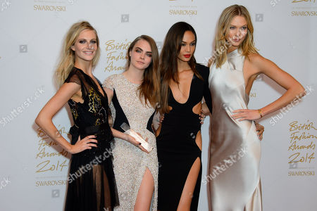 Cara Delevingne with the award for Model of the Year alongside Karlie Kloss, Joan Smalls and Poppy Delevinge during the 2014 British Fashion Awards at a central London venue, London