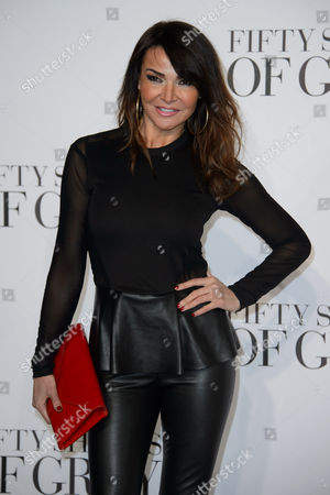 Stock Image of Lizzy Cundy poses for photographers at the UK Premiere of Fifty Shades of Grey, at a central London cinema