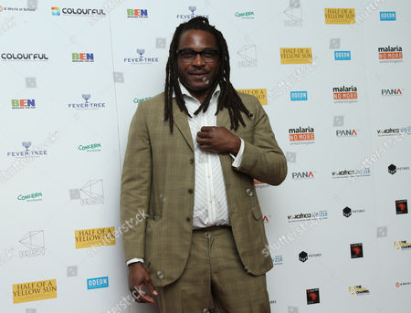 Director Biyi Bandele arrives on the red carpet for the UK film premiere of Half Of A Yellow Sun at a cinema in Streatham, south London