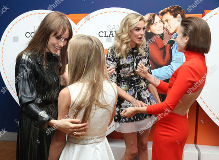 From left, actors Suki Waterhouse, Lily Laight Tamsin Egerton and Lily Collins, chat upon arrival at at the Odeon West End in London, for the premiere of the film Love, Rosie