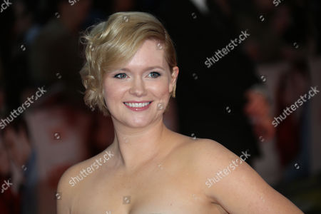 Writer Cecelia Ahern poses for photographers upon arrival at the premiere of the film Love, Rosie in London
