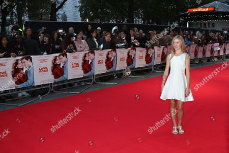 Actress Lily Laight poses for photographers upon arrival at the premiere of the film Love, Rosie in London