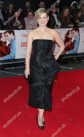 Cecelia Ahern poses for photographers upon arrival at at the Odeon West End in London, for the premiere of the film Love, Rosie