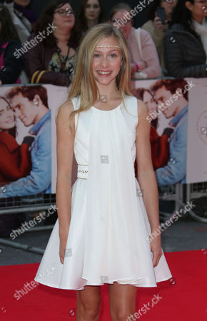 Lily Laight pose for photographers upon arrival at at the Odeon West End in London, for the premiere of the film Love, Rosie