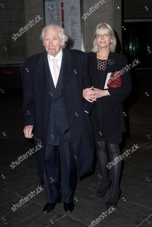 English actor Frank Finlay and guest arrive at National Theatre: 50 Years on Stage, a live performance broadcast on television and to cinemas internationally to celebrate the National Theatre's 50th anniversary in London, on