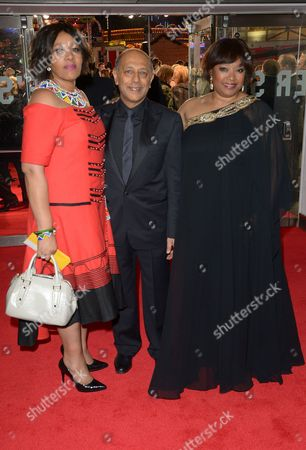 Producer Anant Singh (centre) with Zindzi Mandela (right) and her sister Zenani attend the UK Premiere of 'Mandela: Long Walk To Freedom' at the Odeon Leicester Square in London on
