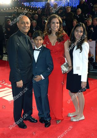 Producer Anant Singh and his family attend the UK Premiere of 'Mandela: Long Walk To Freedom' at the Odeon Leicester Square in London on