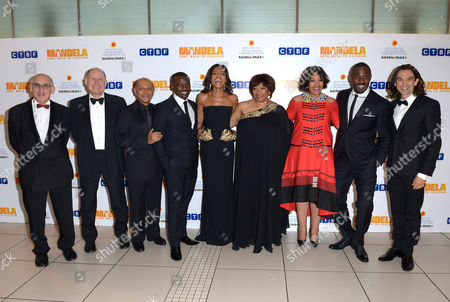 From third left to right, Anant Singh, Tony Kgoroge, Naomie Harris, Zindzi Mandela, her sister Zenani, Idris Elba and Justin Chadwick and pose for photographers at the UK Premiere of 'Mandela: Long Walk To Freedom' at the Odeon Leicester Square in London on