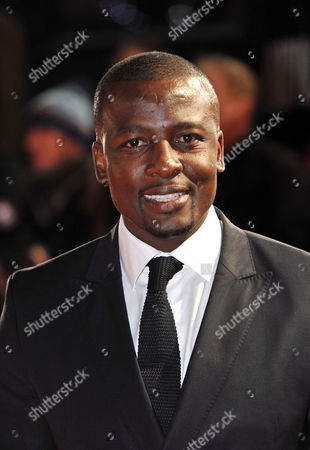 Tony Kgoroge arrives at the UK Premiere of 'Mandela: Long Walk To Freedom' at the Odeon Leicester Square in London on
