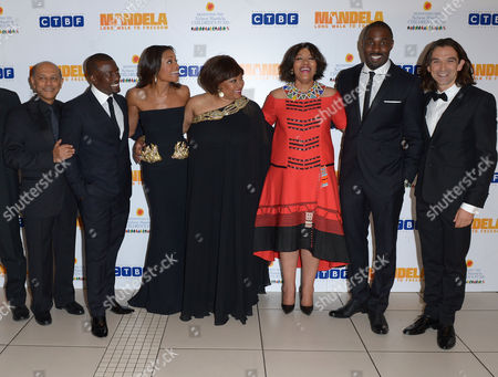 From left to right, Anant Singh, Tony Kgoroge, Naomie Harris, Zindzi Mandela, her sister Zenani, Idris Elba and Justin Chadwick and pose for photographers at the UK Premiere of 'Mandela: Long Walk To Freedom' at the Odeon Leicester Square in London on