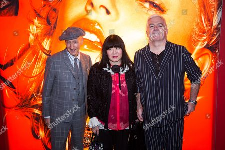 Stephen Jones, Anna Sui and Tim Blanks pose for photographers upon arrival at the Sam McKnight exhibition, in London