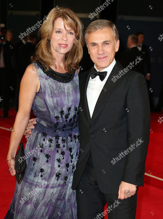 """Christoph Waltz, right, and Judith Holste pose for photographers upon arrival for the World Premiere of """"Spectre"""" at the Royal Albert Hall in central London on"""