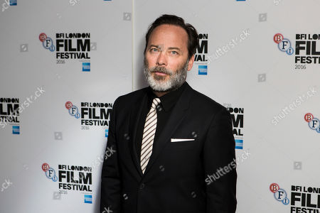 Director Derrick Borte poses for photographers on arrival at the premiere of the film 'London Town', showing as part of the London Film Festival in London