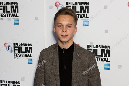 Actor Daniel Huttlestone poses for photographers on arrival at the premiere of the film 'London Town', showing as part of the London Film Festival in London
