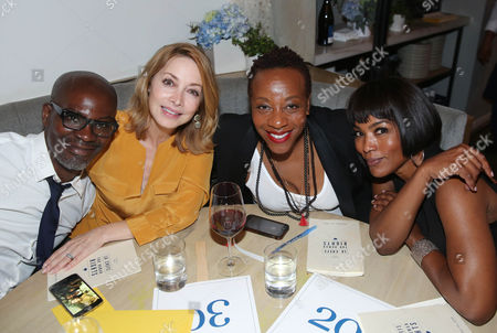 From left, Evan Williams, Sharon Lawrence, Marianne Jean-Baptiste, and Angela Bassett pose for a photo at LA Chefs for Human Rights at Cassia in Santa Monica, Calif. on