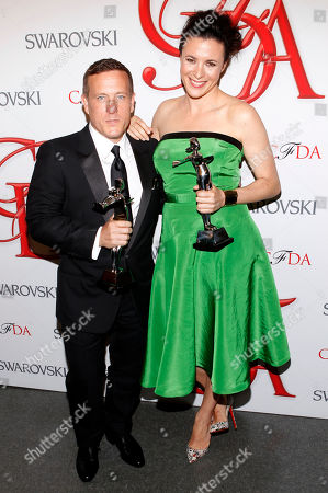 Scott Schuman and Garance Dore pose backstage after winning the Media Award at the CFDA Fashion Awards on in New York