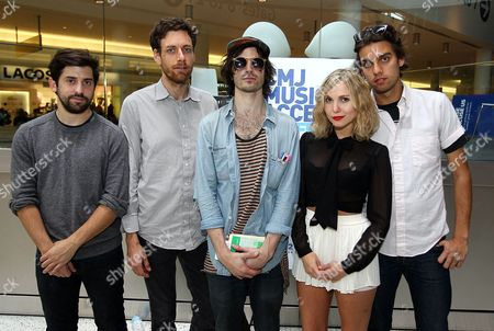 Sam Sugarman left, Jason Boesel second left, Alex Greenwald center, Z berg and Michael Runion poses for a photograph at the CMJ Music Access Live From T5 concert at JetBlue's Terminal 5 at JFK Airport in New York
