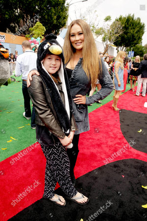 "Bianca Wakelin and Tia Carrere seen at Columbia Pictures and Rovio Animations Premiere of ""The Angry Birds Movie"" at Regency Village Theatre, in Los Angeles"