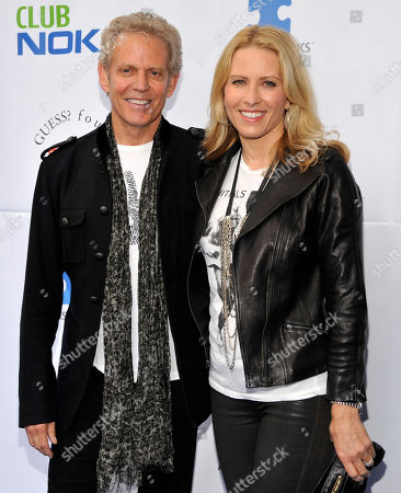 Guitarist Don Felder poses with Kathryn Nicholson at the Light Up The Blues Concert - An Evening of Music Benefitting Autism Speaks, at Club Nokia on in Los Angeles