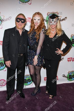 TV personality Elizabeth Stanton (center) with parents David McKenzie (L) and Laura McKenzie arrive at Elizabeth Stanton's 18th birthday benefiting Toys for Tots at Belasco Theatre on in Los Angeles