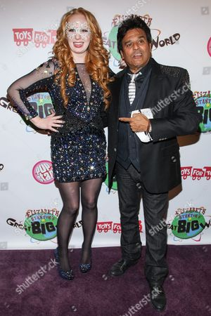 TV personality Elizabeth Stanton (L) and actor Erik Estrada arrive at Elizabeth Stanton's 18th birthday benefiting Toys for Tots at Belasco Theatre on in Los Angeles