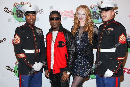 Recording artist Iyaz (L) and TV personality Elizabeth Stanton arrive at Elizabeth Stanton's 18th birthday benefiting Toys for Tots at Belasco Theatre on in Los Angeles