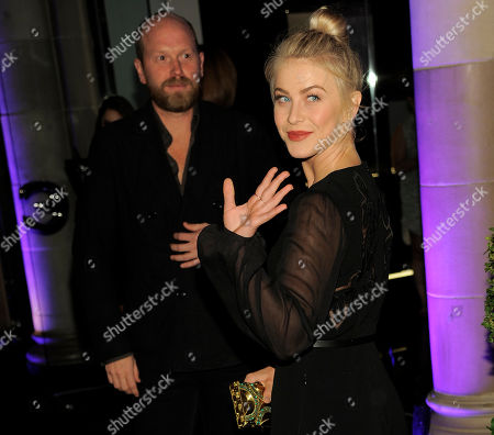 Julianne Hough waves as she arrives at the Escada and W Magazine celebration of the Cool Earth Organization at the Escada Boutique on in Beverly Hills, Calif. Looking on is Escada fashion director Daniel Wingate