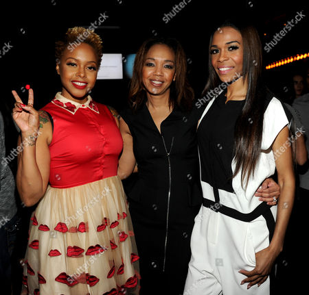 From left, Chrisette Michele, ESSENCE Multicultural Marketing Mgr. Shawn Thompson and Michelle Williams attend the 5th Annual ESSENCE Black Women in Music reception, on at 1 OAK in Los Angeles, Calif