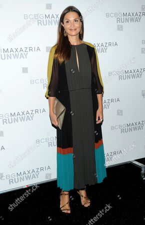 Stock Photo of French actress Barbara Schultz poses before the BCBG MAX AZRIA Spring 2013 collection is shown at Fashion Week in New York