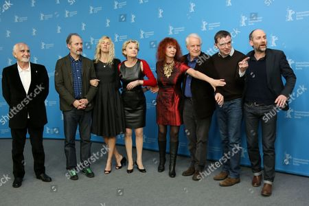 From left, producer Jean-Louis Livi, actors Hippolyte Girardot, Sandrine Kiberlain, Caroline Sihol, Sabine Azema and Andre Dussollier, screenwriter Jean-Marie Besset and illustrator Blutch real name Christian Hincker, attend the photo call for the film Life of Riley during the Berlinale International Film Festival, in Berlin