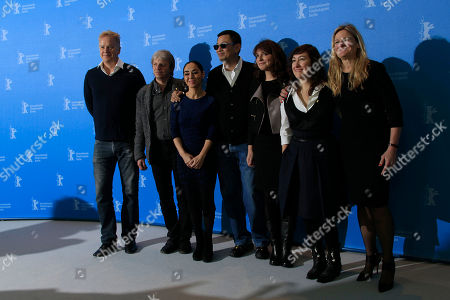 From left jury members Tim Robbins, Andreas Dresen, Shirin Neshat, jury president Wong Kar Wai, Susanne Bier, Athina Rachel Tsangari and Ellen Kuras pose at the photo call during the jury press conference at the 63rd edition of the Berlinale, International Film Festival in Berlin