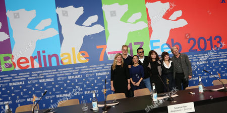 Jury members from left Ellen Kuras, Tim Robbins, Shirin Neshat, jury president Wong Kar Wai, Susanne Bier, Athina Rachel Tsangari and Andreas Dresen pose together for photographers during the jury press conference at the 63rd edition of the Berlinale, International Film Festival in Berlin