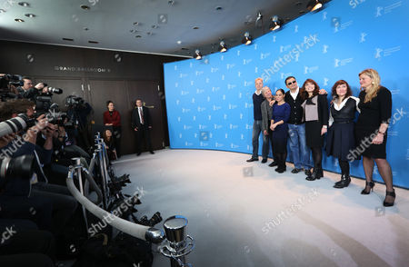 From left jury members Tim Robbins, Andreas Dresen, Shirin Neshat, jury president Wong Kar Wai, Susanne Bier, Athina Rachel Tsangari and Ellen Kuras pose at the photo call during the jury press conference at the 63rd edition of the Berlinale, International Film Festival in Berlin, Germany